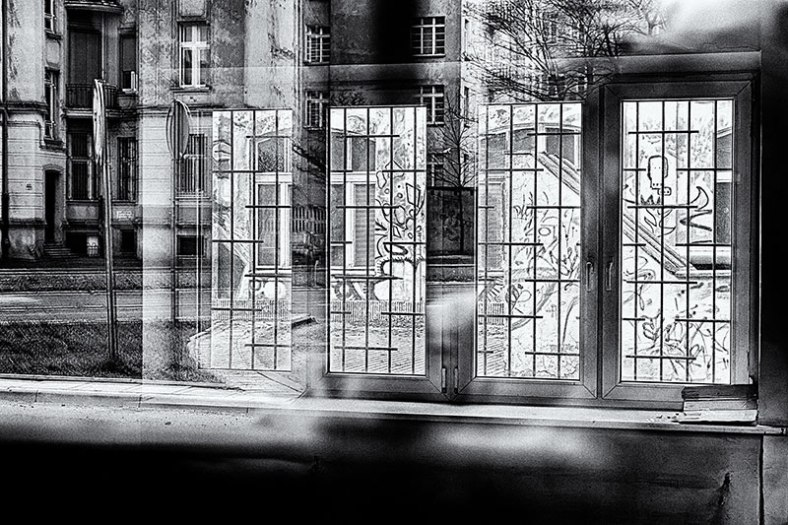 graffiti-and-reflection-though-a-class-room