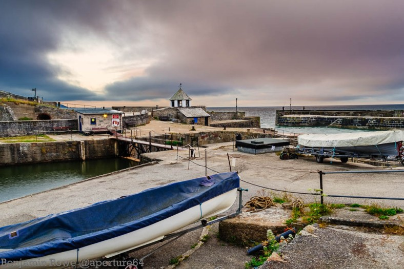 Inner and outer harbour for left side of the harbour at sunrise with two gigs in the foreground